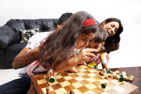 Portrait of a family playing chess photo