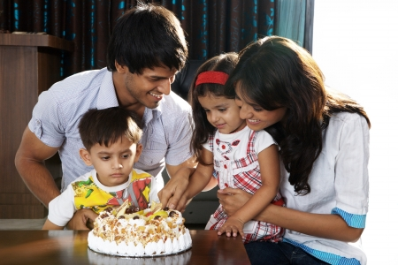 Parents with children celebrating birthday party