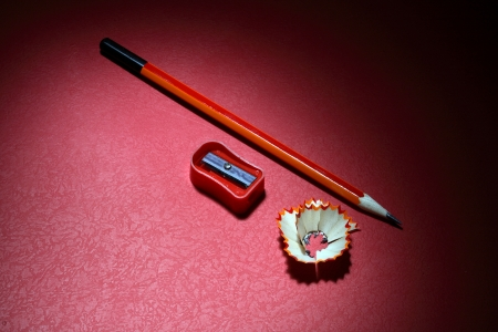 Close-up of a pencil and a sharpener