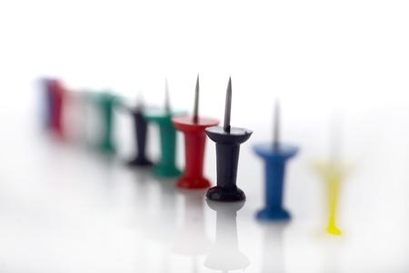 Push pins arranged in a line Standard-Bild