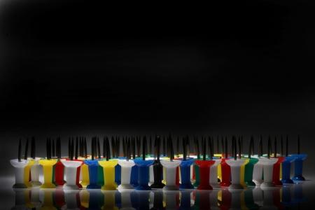 Push pins against black background Standard-Bild