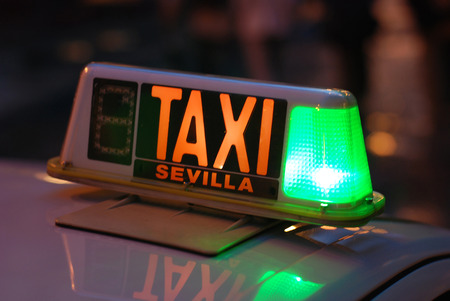 seville: taxi sign seville by night