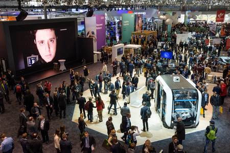 Hannover, Germany - March 22, 2017: Overview on the IBM booth at the CeBIT 2017 with a crowd of people. CeBIT is the world's largest trade fair for information technology.