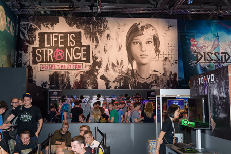 Cologne, Germany - August 24, 2017: Trade fair visitors playing the game life is strange and waiting for it at the booth of the company square enix at Gamescom 2017. Gamescom is a trade fair for video games held annually in Cologne.