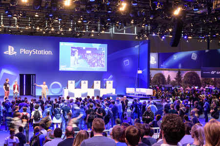 Cologne, Germany - August 24, 2017: Playstation presentation of the company Sony in front of a crowd of people at Gamescome 2017. Gamescom is a trade fair for video games held annually in Cologne. 報道画像