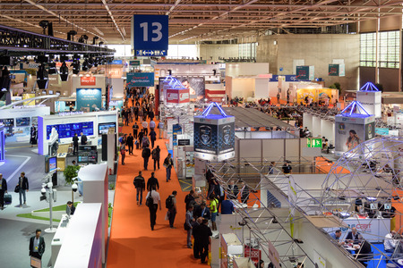 Hannover, Germany - June 13, 2018: Overview of Hall 13 with several booths at the CeBIT 2018. CeBIT is the world's largest trade fair for information technology. Редакционное