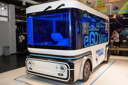 Hannover, Germany - June 13, 2018: Electric minibus e.GO Mover with option for autonomous driving on the booth of the company at CeBIT 2018. CeBIT is the worlds largest trade fair for information technology. Editöryel