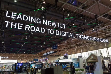Hannover, Germany - June 13, 2018: Big neon sign in top of the huge booth of Huawei at CeBIT 2018. CeBIT is the worlds largest trade fair for information technology. Editorial
