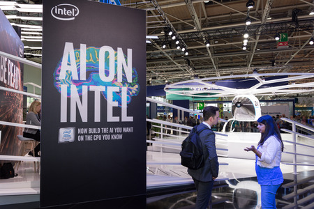 Hannover, Germany - June 13, 2018: Part of the Intel booth with fair visitors and velocopter in the background at CeBIT 2018. CeBIT is the world's largest trade fair for information technology.