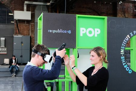 Berlin, Germany - May 3, 2018: A visitor of the re: publica tests virtual reality equipment at the stand of the goethe institute. re:publica is a conference about Web 2.0, social media and the digital society.