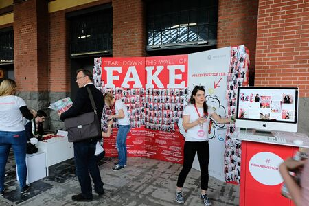 Berlin, Germany - May 3, 2018: Activists of the agency Fink & Fuchs inform about fake news at re:publica 2018 . re:publica is a conference about Web 2.0, weblogs, social media and the digital society.