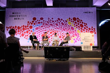 Berlin, Germany - May 3, 2018: Panel discussion with four participants on stage of Media Convention Berlin which takes place as part of re: publica. re:publica is a conference about Web 2.0, weblogs, social media and the digital society.