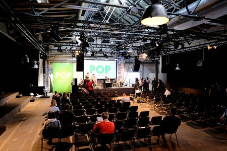 Berlin, Germany - May 3, 2018: View on a lightly frequented conference hall of the of re:publica 2018 with visitors. re:publica is a conference about Web 2.0, especially weblogs, social media and the digital society.