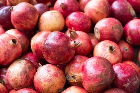 Bunch of red pomegranates at the market 写真素材