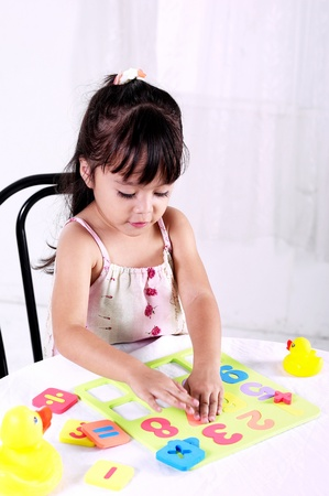 Girl playing with educational toy Stock Photo - 11608790