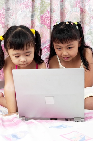 Girls using laptop Stock Photo - 11608823