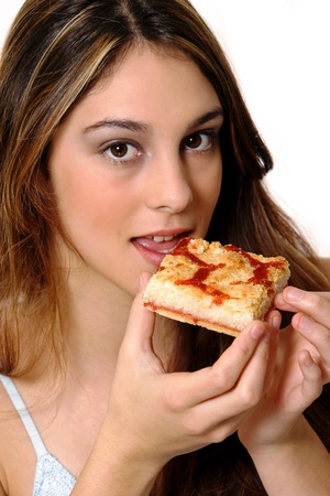 A woman eating a piece of pizza Stock Photo - 11609219