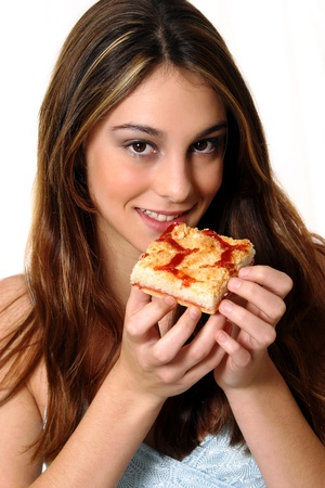A woman posing with a piece of pizza while looking at the camera Stock Photo - 11609218