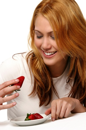 A woman taking a strawberry from a plate of strawberries Stock Photo - 11609261