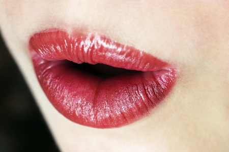 An up-close picture of an opened lips with red lipstick Stock Photo - 11609439
