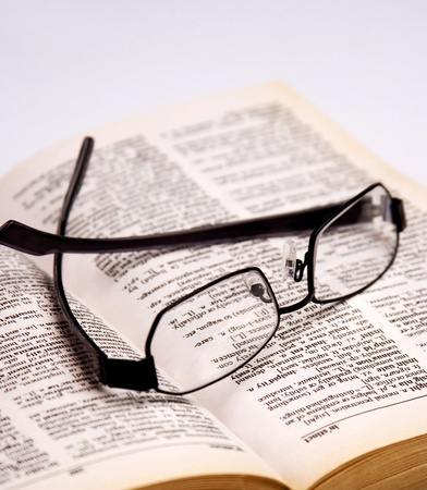 Spectacles on an opened book Stock Photo - 11606299
