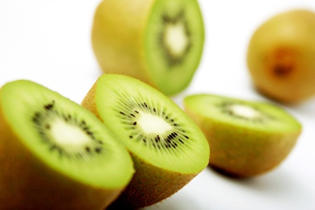 One whole and four halved kiwi fruits Stock Photo - 11606294