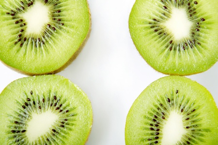 Four halved kiwi fruits Stock Photo - 11609875