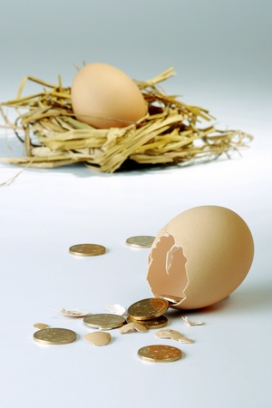 Coins coming out from a broken egg