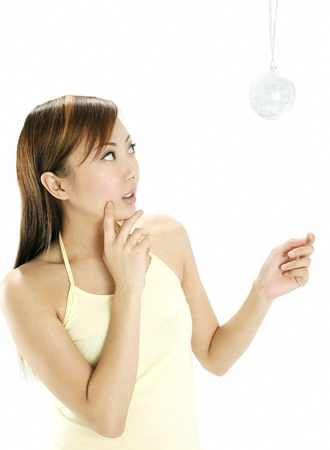 Woman looking at hanging christmas ornament Stock Photo - 11609994