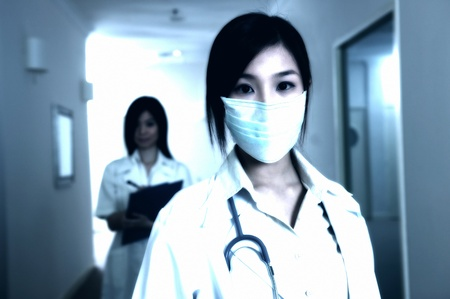 Female doctor wearing mask for hygiene purpose Stock Photo - 11629086