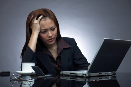 Depressed business woman facing some problems with her work LANG_EVOIMAGES