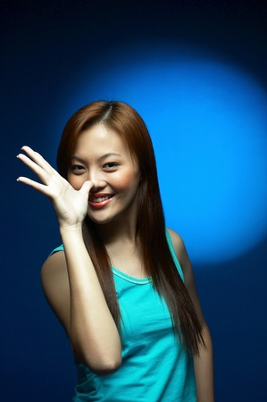 Studio shot of woman striking a cute pose Stock Photo - 11629225
