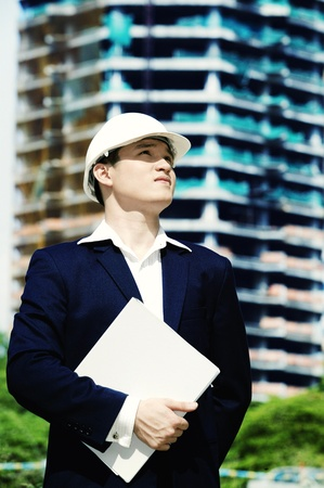 An architect with safety helmet standing at a construction site Stock Photo - 11629553