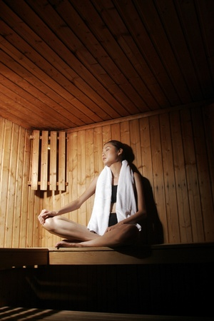 Woman relaxing in sauna. Stock Photo - 11629773