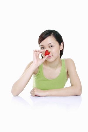 Woman holding strawberry. Stock Photo - 11629883