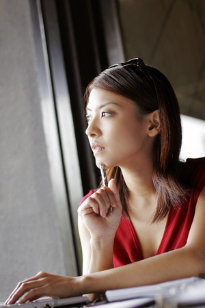 Businesswoman thinking. LANG_EVOIMAGES