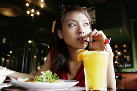 Businesswoman enjoying her lunch. Stock Photo - 11629999