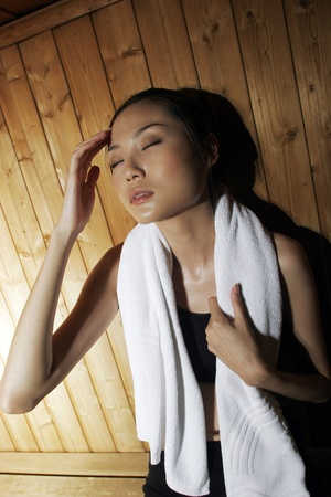 Woman relaxing in sauna. Stock Photo - 11630054