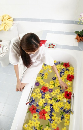 Woman preparing flower bath. Stock Photo - 11630070