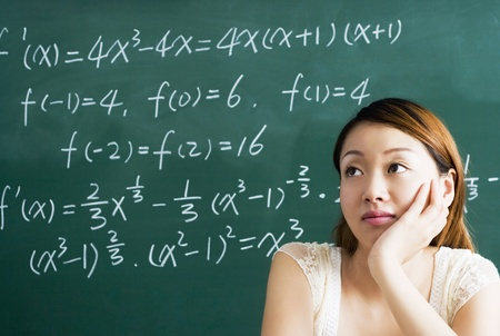 Young woman daydreaming in the classroom Stock Photo - 11630392