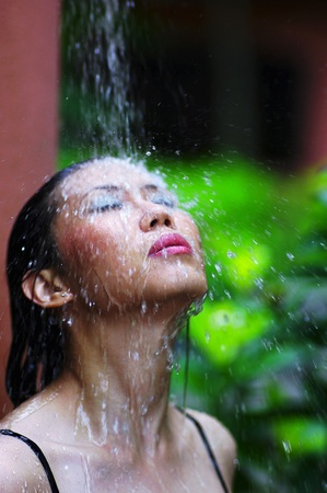 Woman in bikini taking shower Stock Photo - 12593559