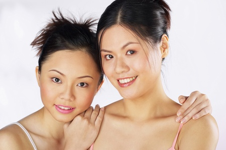 Two women looking at the camera smiling Stock Photo - 12593652