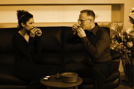 Man and woman having their sip of tea Stock Photo - 12593660