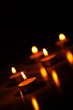 Lit candles glowing in the dark Stock Photo - 12642166