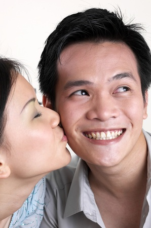 Woman kissing her boyfriend Stock Photo - 12642439