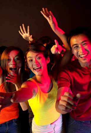 Teenagers screaming in a concert Stock Photo - 12642494