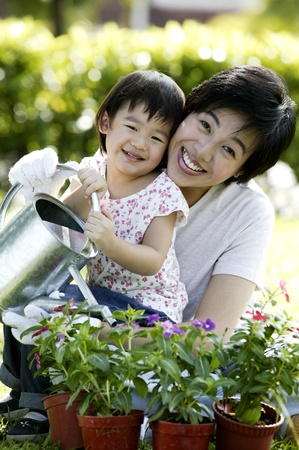 Mother and daughter watering plants Stock Photo - 12642730