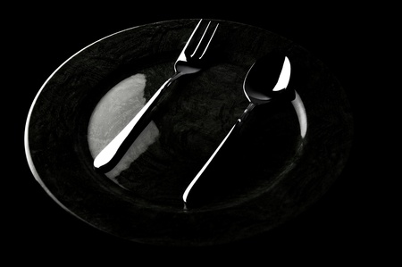 Fork and spoon on a plate Stock Photo - 12642821