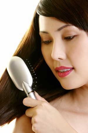 portraits of a woman combing hair Stock Photo - 12642904