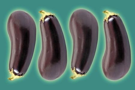 Montage of four Eggplants on Green Stock Photo - 12642925